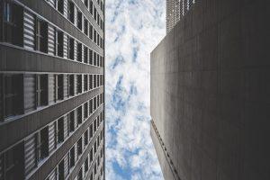 cloudy-sky-between-two-skyscrapers-buildings-picjumbo-com