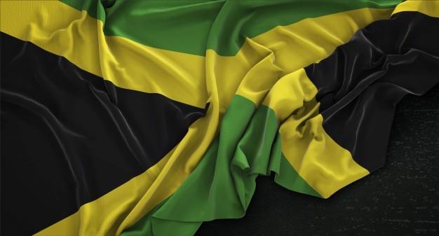jamaika-flagge-geknickt-auf-dunklem-hintergrund-3d-render_1379-592